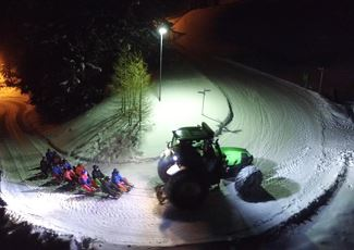 Fun toboggan ride in Warth with tractor drive.